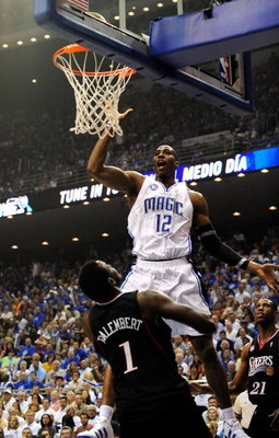 ORLANDO, FL - APRIL 28: Dwight Howard #12 of the Orlando Magic shoots over Samuel Dalembert #1 of the Philadelphia 76ers in Game Five of the Eastern Conference Quarterfinals during the 2009 NBA Playoffs at Amway Arena on April 28, 2009 in Orlando, Florida