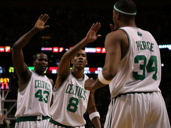 BOSTON - MAY 02:  Stephon Marbury #8 and Kendrick Perkins #43 of the Boston Celtics celebrate with teammate Paul Pierce #34 after Pierce drew the foul in the first half against the Chicago Bulls in Game Seven of the Eastern Conference Quarterfinals during