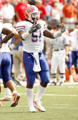 OXFORD, MS - SEPTEMBER 22: Brandon Spikes #51 of the Florida Gators reacts after a play against the Mississippi Rebels on September 22, 2007 at Vaught-Hemingway Stadium/Hollingsworth Field in Oxford, Mississippi. Florida won  30-24. (Photo by Joe Murphy/G