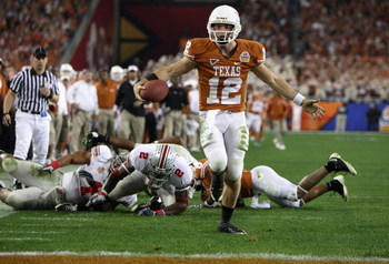 GLENDALE, AZ - JANUARY 05:  Quarterback Colt McCoy #12 of the Texas Longhorns scores on a 14 yard touchdown rush against the Ohio State Buckeyes during the third quarter of the Tostitos Fiesta Bowl Game on January 5, 2009 at University of Phoenix Stadium