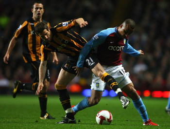 BIRMINGHAM, ENGLAND - MAY 04:  Gabriel Agbonlahor of Aston Villa tussles for posession with Samuel Ricketts of Hull City during the Barclays Premier League match between Aston Villa and Hull City at Villa Park on May 4, 2009 in Birmingham, England. (Photo