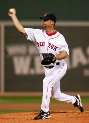 BOSTON - OCTOBER 14:  Starting pitcher Tim Wakefield #49 of the Boston Red Sox delivers against the Tampa Bay Rays in game four of the American League Championship Series during the 2008 MLB playoffs at Fenway Park on October 14, 2008 in Boston, Massachus
