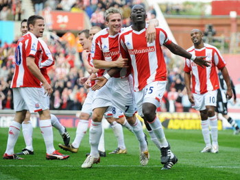 STOKE, UNITED KINGDOM - APRIL 11:  Abdoulaye Faye of Stoke City celebrates with Liam Lawrence as he scores their first goal during the Barclays Premier League match between Stoke City and Newcastle United at the Britannia Stadium on April 11, 2009 in Stok