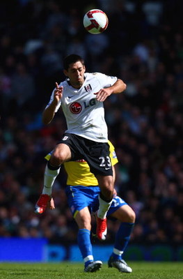 LONDON, ENGLAND - APRIL 25:  Clint Dempsey of Fulham heads the ball during the Barclays Premier League match between Fulham and Stoke City at Craven Cottage on April 25, 2009 in London, England.  (Photo by Ryan Pierse/Getty Images)