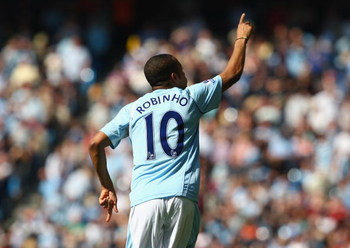 MANCHESTER, ENGLAND - APRIL 19:  Robinho of Manchester City celebrates scoring the opening goal during the Barclays Premier League match between Manchester City and West Bromwich Albion at the City of Manchester Stadium on April 19, 2009 in Manchester, En