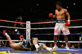 LAS VEGAS - MAY 02:  (R-L) Manny Pacquiao of the Philippines stands over Ricky Hatton of England after Pacquiao knocked him out in the second round during their junior welterweight title fight at the MGM Grand Garden Arena May 2, 2009 in Las Vegas, Nevada