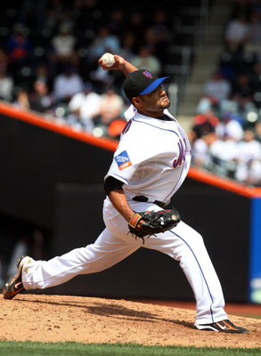 NEW YORK - APRIL 29:  Johan Santana #57 of the New York Mets delivers a pitch against the Florida Marlins on April 29, 2009 at Citi Field in the Flushing neighborhood of the Queens borough of New York City. The Marlins defeated the Mets 4-3.  (Photo by Ji