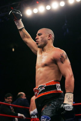 NEW YORK - FEBRUARY 21:  Miguel Cotto celebrates a 5th round TKO over Michael Jennings in their WBO World Welterweight title bout at Madison Square Garden on February 21, 2009 in New York City.  (Photo by Chris Trotman/Getty Images)