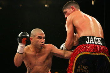 NEW YORK - FEBRUARY 21:  Michael Jennings (R) and Miguel Cotto (L) exchange punches during their WBO World Welterweight title bout at Madison Square Garden on February 21, 2009 in New York City.  (Photo by Chris Trotman/Getty Images)
