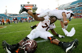 JACKSONVILLE, FL - DECEMBER 1:  Cornerback Victor Harris #1 and offensive lineman Sergio Render #70 of the Virginia Tech Hokies celebrate after defeating the Boston College Eagles in the ACC Championship Game at Jacksonville Municipal Stadium December 1,
