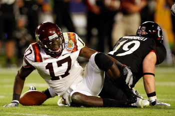 MIAMI - JANUARY 01:  Kam Chancellor #17 of the Virginia Tech Hokies reacts in pain after making an interception during the FedEx Orange Bowl against the Cincinnati Bearcats at Dolphin Stadium on January 1, 2009 in Miami, Florida.  (Photo by Streeter Lecka