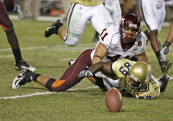 ATLANTA - NOVEMBER 1:  Wide receiver James Johnson #89 of the Georgia Tech Yellow Jackets fumbles as he is tackled by linebacker Cam Martin #41 of the Virginia Tech Hokies during the game on November 1, 2007 at Bobby Dodd Stadium at Historic Grant Field i