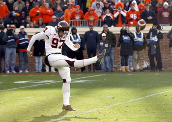 CHARLOTTESVILLE, VA - NOVEMBER 24: Brent Bowden #97 of the Virginia Tech Hokies punts during the game against the Virginia Cavaliers at Scott Stadium on November 24, 2007 in Charlottesville, Virginia. Virginia Tech defeated Virginia 33-21. (Photo by Kevin