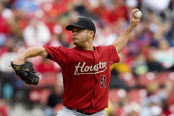 ST. LOUIS, MO - APRIL 12: Starting pitcher Wandy Rodriguez #51 of the Houston Astros throws against the St. Louis Cardinals on April 12, 2009 at Busch Stadium in St. Louis, Missouri.  The Cardinals beat the Astros 3-0.  (Dilip Vishwanat/Getty Images)