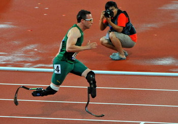 BEIJING, CHINA - SEPTEMBER 16:  Oscar Pistorius of South Africa wins Gold with a World Record in the 400m T44 during day 10 of the 2008 Beijing Paralympic Games held in Beijing, China.  (Photo by Duif du Toit/Gallo Images/Getty Images)