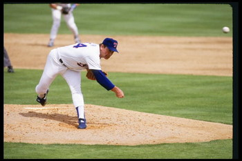 10 Mar 1992:  Nolan Ryan of the Texas Rangers throws a pitch during a game against the Chicago White Sox at Comiskey Park in Chicago, Illinios.  Mandatory Credit: Jonathan Daniel  /Allsport