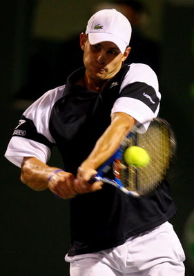 KEY BISCAYNE, FL - APRIL 01:  Andy Roddick returns a shot against Roger Federer of Switzerland during day ten of the Sony Ericsson Open at the Crandon Park Tennis Center on April 1, 2009 in Key Biscayne, Florida.  (Photo by Al Bello/Getty Images)