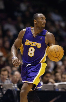 EAST RUTHERFORD, NJ - DECEMBER 19:  Kobe Bryant #8 of the Los Angeles Lakers moves the ball during the NBA game against the New Jersey Nets at Continental Airlines Arena on December 19, 2002 in East Rutherford, New Jersey.  The Nets won 98-71.  NOTE TO US