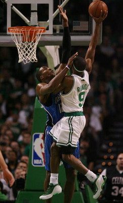 BOSTON - MAY 04:  Dwight Howard #12 of the Orlando Magic fouls Rajon Rondo #9 of the Boston Celtics in Game One of the Eastern Conference Semifinals during the 2009 NBA Playoffs at TD Banknorth Garden on May 4, 2009 in Boston, Massachusetts. The Magic def