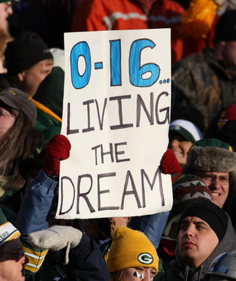 GREEN BAY, WI - DECEMBER 28:  Fans hold a sign during a game between the Green Bay Packers and the Detroit Lions on December 28, 2008 at Lambeau Field in Green Bay, Wisconsin. The Packers defeated the Lions 31-21. (Photo by Jonathan Daniel/Getty Images)