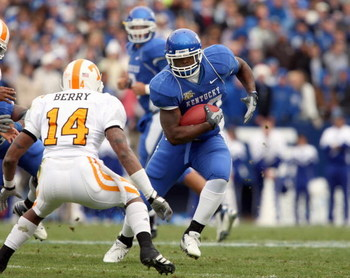 LEXINGTON, KY - NOVEMBER 24: Rafael Little #22 of the Kentucky Wildcats carries the ball during the SEC game against Eric Berry #14 of the Tennessee Volunteers at Commonwealth Stadium November 24, 2007 in Lexington, Kentucky. Tennessee won the game 52-50