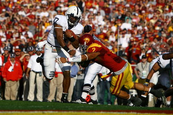 PASADENA, CA - JANUARY 01:  Quarterback Daryll Clark #17 of the Penn State Nittany Lions jumps over Taylor Mays #2 of the USC Trojans to score a touchdown in the first quarter of the 95th Rose Bowl Game presented by Citi on January 1, 2009 at the Rose Bow