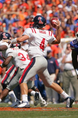 GAINESVILLE, FL - SEPTEMBER 27:  Quarterback Jevan Snead #4 Mississippi Rebels passes the ball during the game against the Florida Gators during the game at Ben Hill Griffin Stadium on September 27, 2008 in Gainesville, Florida.  (Photo by Sam Greenwood/G