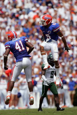 GAINESVILLE, FL - AUGUST 30:  Defensive back Joe Haden #5 and linebacker Ryan Stamper #41 of the Florida Gators celebrate during a game against the Hawaii Warriors at Ben Hill Griffin Stadium on August 30, 2008 in Gainesville, Florida.  (Photo by Sam Gree