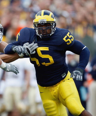 ANN ARBOR, MI - SEPTEMBER 15:  Brandon Graham #55 of the Michigan Wolverines pass rushes against the Notre Dame Fighting Irish on September 15, 2007 at Michigan Stadium in Ann Arbor, Michigan. Michigan won 38-0. (Photo by Gregory Shamus/Getty Images)
