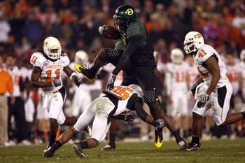 SAN DIEGO, CA - DECEMBER 30:   Runningback LeGarrette Blount #9 of the University of Oregon Ducks hurdles a player en route to a touchdown during his team's 42-31 win over the Oklahoma State University Cowboys in the Pacific Life Holiday Bowl at Qualcomm