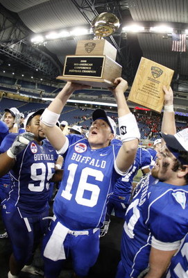 DETROIT - DECEMBER 05: Drew Willy #16 of the Buffalo Bulls celebrates with teammates the MAC Championship after defeating the Ball State Cardinals on December 5, 2008 at Ford Field in Detroit, Michigan. (Photo by Gregory Shamus/Getty Images)