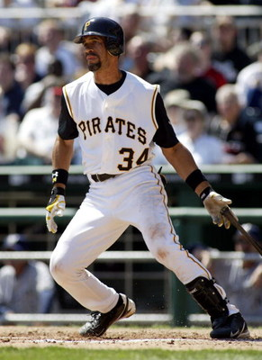 PITTSBURGH - APRIL 6:  Benito Santiago #34 of the Pittsburgh Pirates bats against the Milwaukee Brewers during the game on April 6, 2005 at PNC Park in Pittsburgh, Pennsylvania.  The Brewers won 10-2.  (Photo by Rick Stewart/Getty Images)