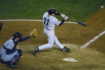 BRONX, NY - OCTOBER 22:  Leftfielder Chuck Knoblauch #11 of the New York Yankees hits the ball against the Seattle Mariners during game five of the American League Championship Series on October 22, 2001 at Yankee Stadium in the Bronx, New York.  The Yank