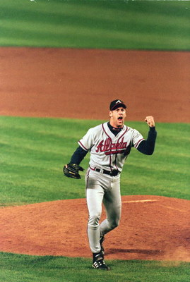 15 Oct 1999: Relief pitcher John Rocker #49 of the Atlanta Braves celebrates on the mound during Game 3 of the National League Championship Series against the New York Mets at Shea Stadium in New York, New York. The Braves defeated the Mets 1-0.