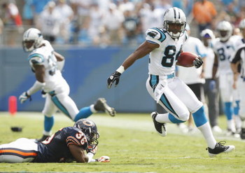 CHARLOTTE, NC - SEPTEMBER 14:  Mark Jones #84 of the Carolina Panthers runs the ball against Brandon McGowan #36 of the Chicago Bears during their NFL game at Bank of America Stadium in Charlotte, North Carolina on September 14, 2008. (Photo by: Streeter