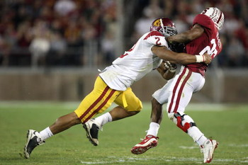 STANFORD - NOVEMBER 15:  Taylor Mays #2 of USC Trojans tackles Delano Howell #26 of the Stanford Cardinals at Stanford Stadium on November 15, 2008 in Stanford, California. (Photo by: Jed Jacobsohn/Getty Images)