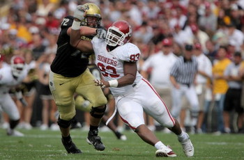 BOULDER, CO - SEPTEMBER 29:  Devin Head #93 of the Colorado Buffaloes block Gerald McCoy #93 of the Oklahoma Sooners at Folsom Field on September 29, 2007 in Boulder, Colorado. Colorado defeated Oklahoma 27-24.  (Photo by Doug Pensinger/Getty Images)