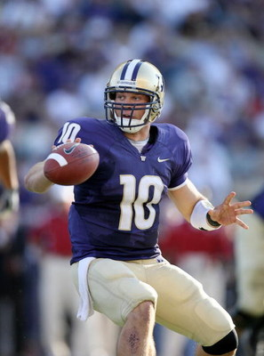 SEATTLE - SEPTEMBER 13:  Quarterback Jake Locker #10 of the Washington Huskies tosses the ball during the game against the Oklahoma Sooners on September 13, 2008 at Husky Stadium in Seattle, Washington. The Sooners defeated the Huskies 55-14.(Photo by Ott