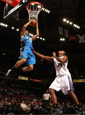 SACRAMENTO, CA - JANUARY 13:  Courtney Lee #11 of the Orlando Magic shoots over Jason Thompson #34 of the Sacramento Kings during an NBA game on January 13, 2009 at ARCO Arena in Sacramento, California. NOTE TO USER: User expressly acknowledges and agrees