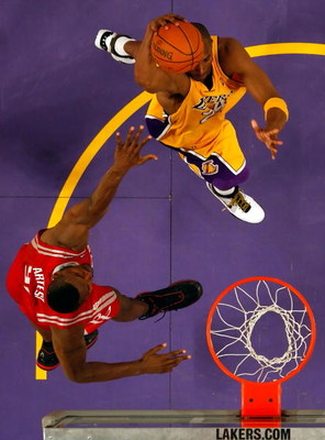 LOS ANGELES, CA - MAY 04:  Kobe Bryant #24 of the Los Angeles Lakers goes up for a dunk over Ron Artest #96 of the Houston Rockets in Game One of the Western Conference Semifinals during the 2009 NBA Playoffs at Staples Center on May 4, 2009 in Los Angele