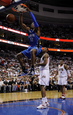PHILADELPHIA - APRIL 24: Dwight Howard #12 of the Orlando Magic dunks against  Theo Ratliff of the Philadelphia 76ers during Game Three of the Eastern Conference Quarterfinals during the 2009 NBA Playoffs at the Wachovia Center on April 24, 2009 in Philad