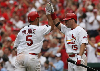 ST. LOUIS, MO - JUNE 8: Jim Edmonds #15 of the St. Louis Cardinals congratulates teammate Albert Pujols #5 after Pujols knocked in three runs against the Milwaukee Brewers at Busch Stadium July 29, 2007 in St. Louis, Missouri.  The Cardinals beat the Brew