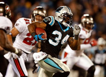 CHARLOTTE, NC - DECEMBER 08:  DeAngelo Williams #34 of the Carolina Panthers runs with the ball during their game against the Tampa Bay Buccaneers at Bank of America Stadium on December 8, 2008 in Charlotte, North Carolina.  (Photo by Streeter Lecka/Getty