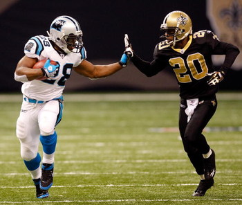 NEW ORLEANS - DECEMBER 28:  Jonathan Stewart #28 of the Carolina Panthers avoids a tackle by Randall Gay #20 of the New Orleans Saints on December 28, 2008 at the Superdome in New Orleans, Louisiana. The Panthers defated the Saints 33-31.  (Photo by Chris