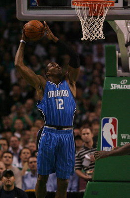 BOSTON - MAY 06:  Dwight Howard #12 of the Orlando Magic takes a shot in the first quarter against the Boston Celtics in Game Two of the Eastern Conference Semifinals during the 2009 NBA Playoffs at TD Banknorth Garden on May 6, 2009 in Boston, Massachuse