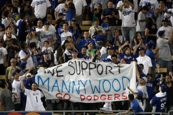 LOS ANGELES - MAY 7:  Fans hold a smuggled in banner supporting suspended Dodger Manny Ramirez during the seventh inning stretch of the game between the Los Angeles Dodgers the Washington Nationals on May 7, 2009 at Dodger Stadiium in Los Angeles, Califor