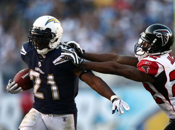 SAN DIEGO, CA - NOVEMBER 30:   Running back LaDainian Tomlinson #21 of the San Diego Chargers runs against the tackle of Chevis Jackson #22 of the Atlanta Falcons during their NFL Game on November 30, 2008 at Qualcomm Stadium in San Diego, California.  (P