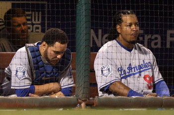 PHILADELPHIA - OCTOBER 10:  (L-R) Russell Martin #55 and Manny Ramirez #99 of the Los Angeles Dodgers look on from the dugout dejected against the Philadelphia Phillies in Game Two of the National League Championship Series during the 2008 MLB playoffs on