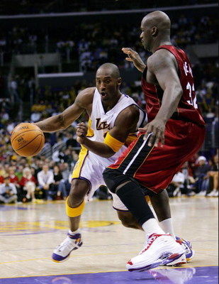 LOS ANGELES - DECEMBER 25:  Kobe Bryant #8 of the Los Angeles Lakers drives on Shaquille O'Neal #32 of the Miami Heat in the third quarter on December 25, 2004 at Staples Center in Los Angeles, California.  NOTE TO USER: User expressly acknowledges and ag