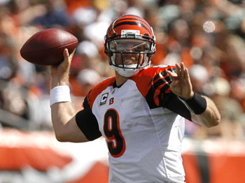 CINCINNATI - SEPTEMBER 14:  Carson Palmer #9 of the Cincinnati Bengals throws the ball against the Tennessee Titans during the first quarter of their NFL game September 14, 2008 at Paul Brown Stadium in Cincinnati, Ohio.  (Photo by Matt Sullivan/Getty Ima
